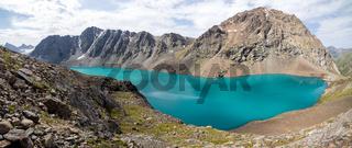 Panoramic view of Ala-Kul lake in Kyrgyzstan