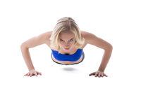 Pretty blonde doing push-ups at camera