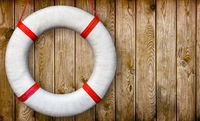 Lifebuoy on a wooden wall