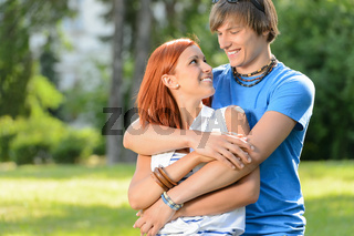 Teenage couple embracing looking at each other