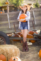 Pretty Preteen Girl Portrait at the Pumpkin Patch