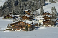 Snow-covered Swiss chalets, Switzerland