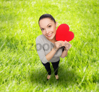 smiling asian woman with red heart
