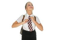 Proud young schoolgirl straightening her tie