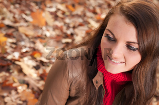 Girl sitting on the leafs