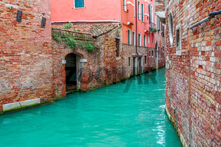 Canal and old houses in Venice, Italy.