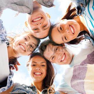 group of teenagers looking down