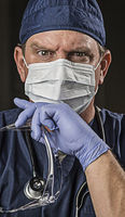 Determined Looking Doctor or Nurse with Protective Wear and Stethoscope