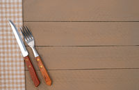 Knife and Fork on wooden background