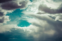 Beautiful blue sky background with dramatic clouds. Vintage style processing image