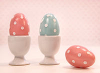 Colorful eggs in white cups