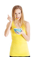 Beautiful caucasian woman eating cereals.