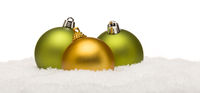 Green and Yellow Christmas Ornaments on Snow Isolated on White