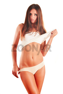 Young slim girl in her underwear isolated on white background