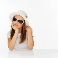 Thoughtful young girl in a fashionable outfit