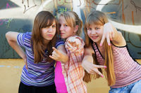 Teenage girls having fun and making peace sign