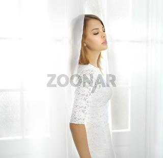 Elegance girl at the window