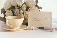 Thank you note with tea cup and roses
