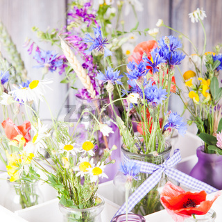 Wildflowers in bottles