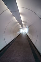 Modern pedestrian tunnel with people silhouettes
