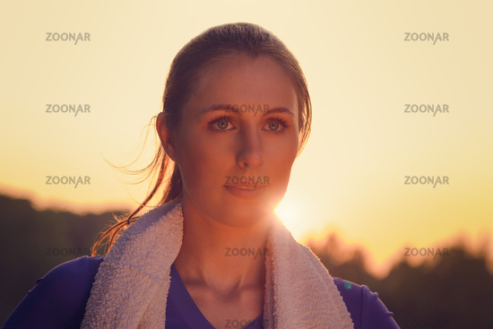 Attractive woman outdoors at sunset