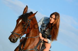 The woman on a horse against the sky