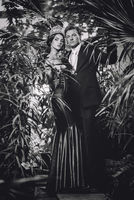Gorgeous lady in long evening dress and with tiara on a head and handsome man in classic suit