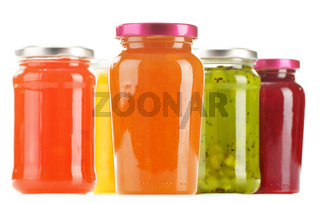 Jars of fruity jams isolated on white background. Preserved fruits