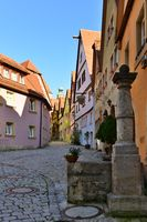 Street of town Rotenburg on Tauber in Germany. Facades of the houses