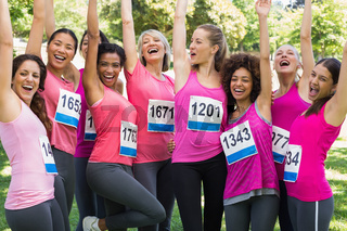 Female breast cancer marathon runners cheering