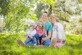 Young Attractive Family Portrait in the Park