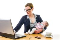 Businesswoman with baby and PC