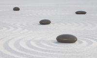 Dark Zen stones on a wide sands