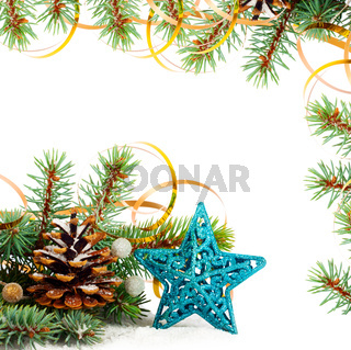 Christmas tree branch with gold serpentine and star on white background isolated