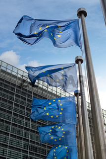 European Union flags in front of the Berlaymont building (European commission) in Brussels, Belgium.