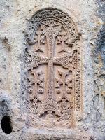 Engraved khachkar at Geghard Monastery in Armenia