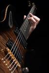 playing vintage brown guitar