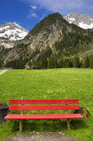 Red bench in the mountains, Austria, Europe