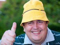 Fat man with yellow sunhat.