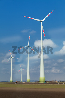 windmills  in cloudy blue sky