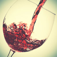 Pouring of red wine