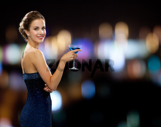 smiling woman holding cocktail