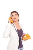attractive woman 50 years with vintage telephone