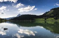 Serene water reflection lake Haldensee Austria