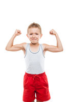 Smiling sport child boy showing hand biceps muscle