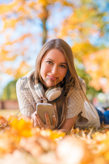 Young woman relaxing with her music in a park