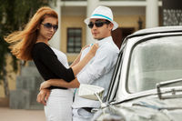 Young fashion couple at the retro car