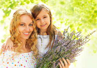 Happy blond mother and her daughter