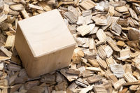 Wooden cube lying on mulch