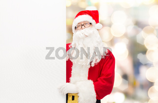 man in costume of santa claus with billboard